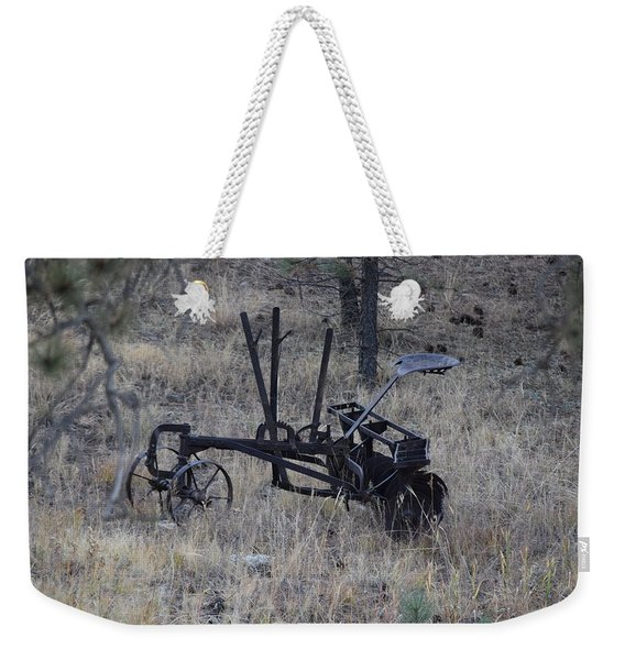 Weekender Tote Bag featuring the photograph Old Farm Implement Lake George Co by Margarethe Binkley
