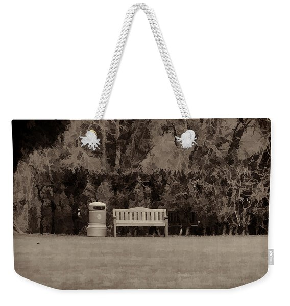 A Trash Can And Wooden Benches In A Small Grassy Area Weekender Tote Bag