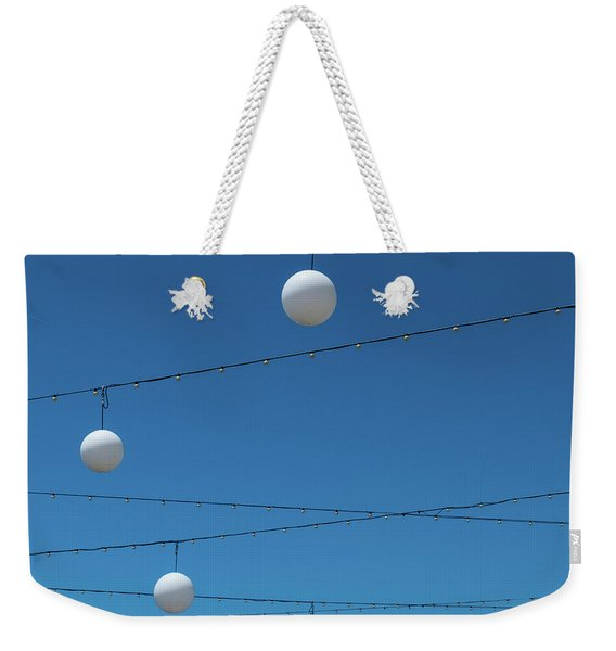 Weekender Tote Bag featuring the photograph 3 Globes by Eric Lake