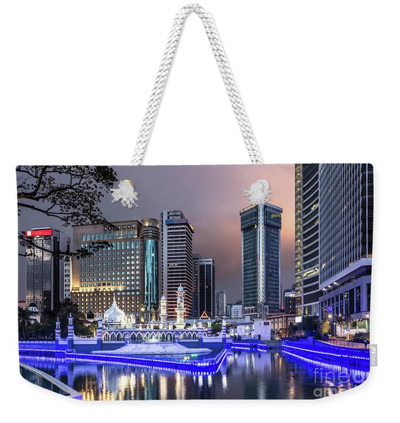 The Office Buildings Reflects In The Water Of The Klang River In Weekender Tote Bag