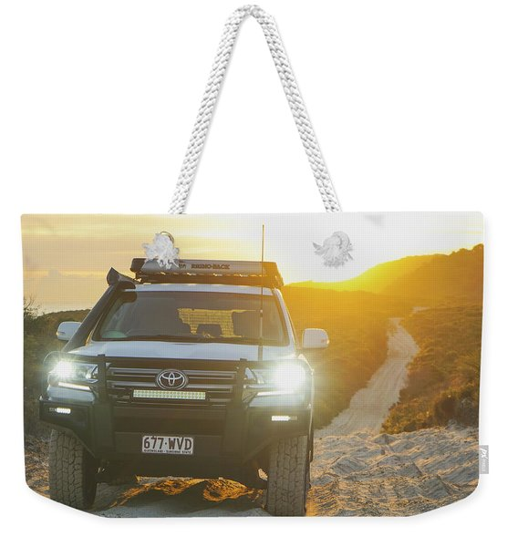 4wd Car Explores Sand Track In Early Morning Light Weekender Tote Bag