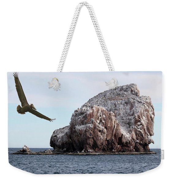 A Brown Pelican Does A Flyby Of A Guano Covered Desert Island  Weekender Tote Bag