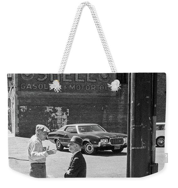 Weekender Tote Bag featuring the photograph A Conversation by Frank DiMarco