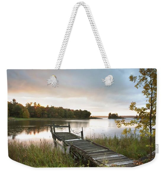 A Dock On A Lake At Sunrise Near Wawa Weekender Tote Bag