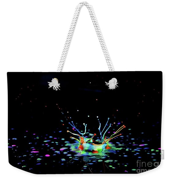 Weekender Tote Bag featuring the photograph A Drop That Is A Crown by Arik Baltinester