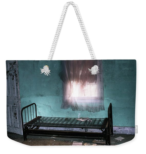 Weekender Tote Bag featuring the photograph A Glow Where She Slept by Wayne King