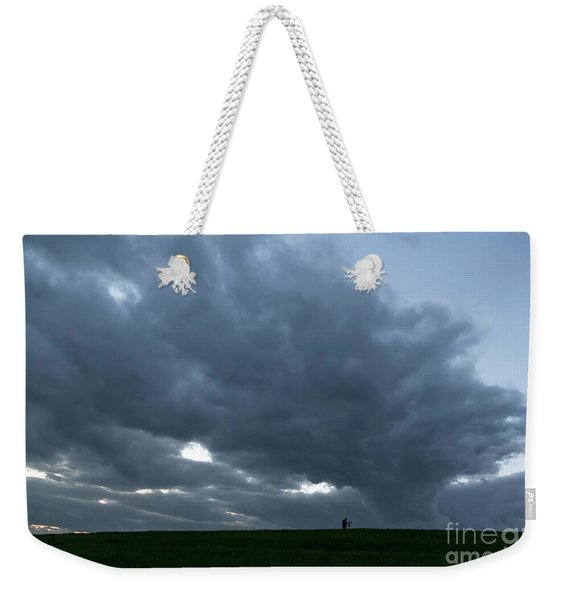Weekender Tote Bag featuring the photograph Alone In The Face Of The Storm by Arik Baltinester