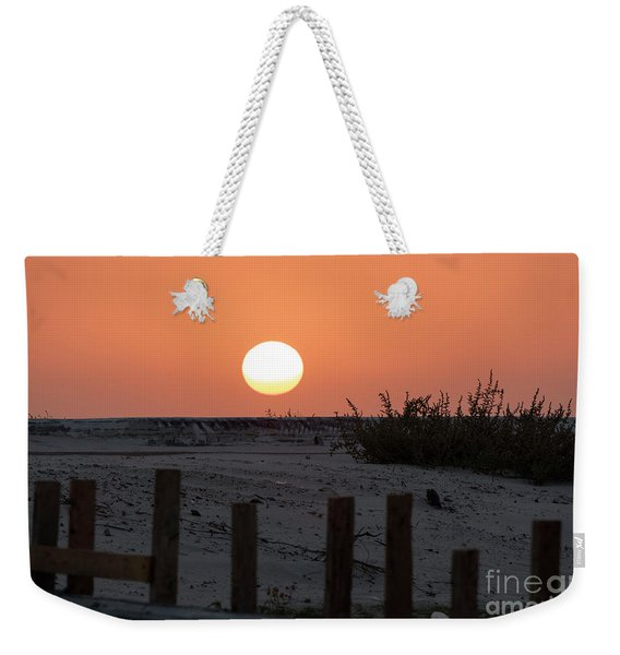 Weekender Tote Bag featuring the photograph A November Sunset Scene by Arik Baltinester