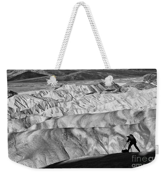 A Photographer Catching The Perfect Light At Zabriskie Point. Weekender Tote Bag