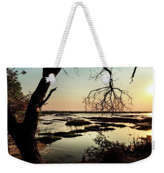 A River Sunset In Botswana Weekender Tote Bag