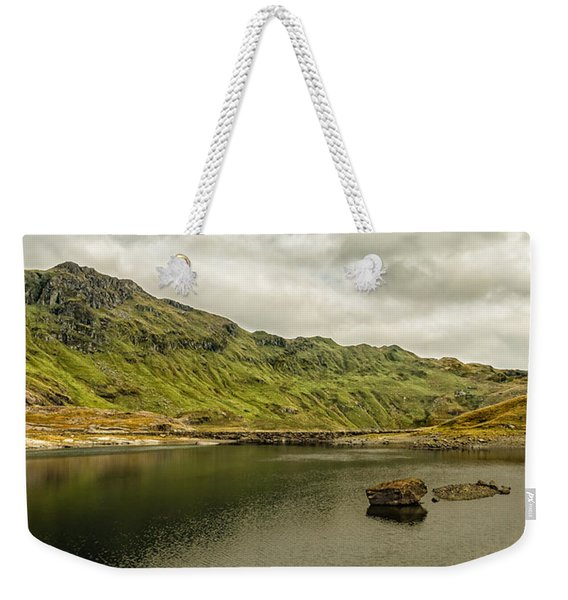 Weekender Tote Bag featuring the photograph A Rock And A Hard Place by Nick Bywater