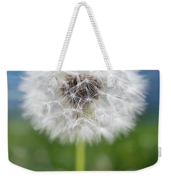A Single Dandelion Seed Pod Weekender Tote Bag