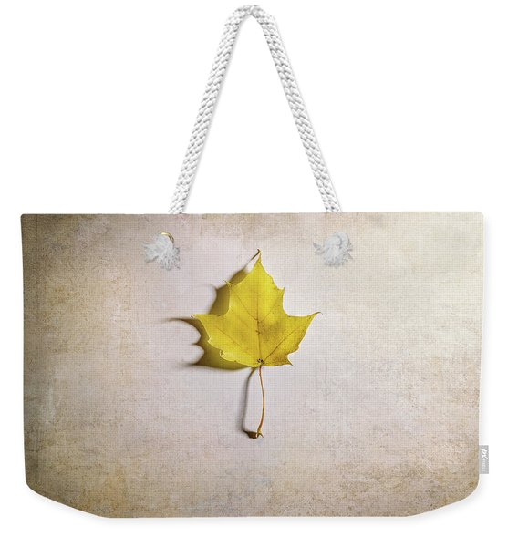 A Single Yellow Maple Leaf Weekender Tote Bag