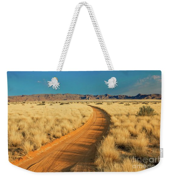 Weekender Tote Bag featuring the photograph African Sand Road by Benny Marty
