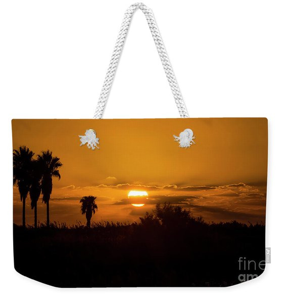Weekender Tote Bag featuring the photograph  African Style Sunset by Arik Baltinester