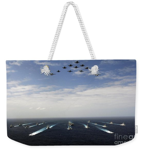 Aircraft Fly Over A Group Of U.s Weekender Tote Bag