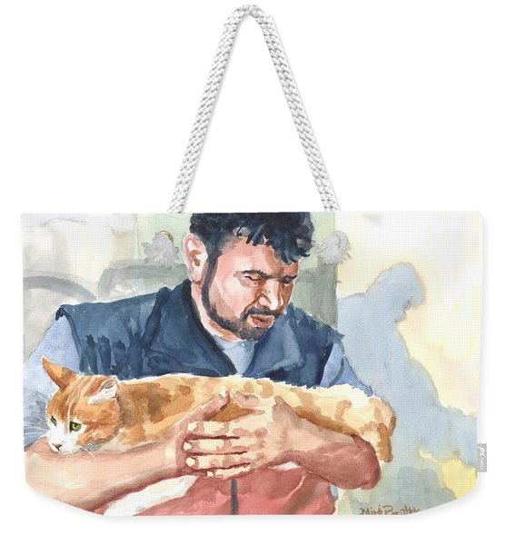 Alaa Rescuing An Injured Cat Weekender Tote Bag