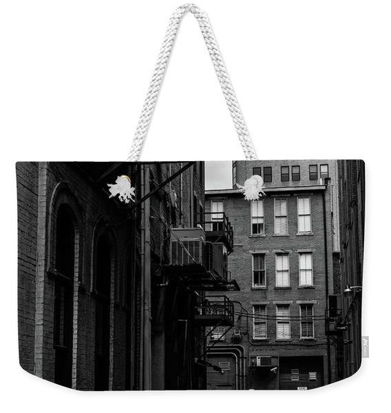 Weekender Tote Bag featuring the photograph Alleyway I by Break The Silhouette