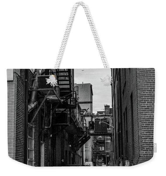 Weekender Tote Bag featuring the photograph Alleyway II by Break The Silhouette