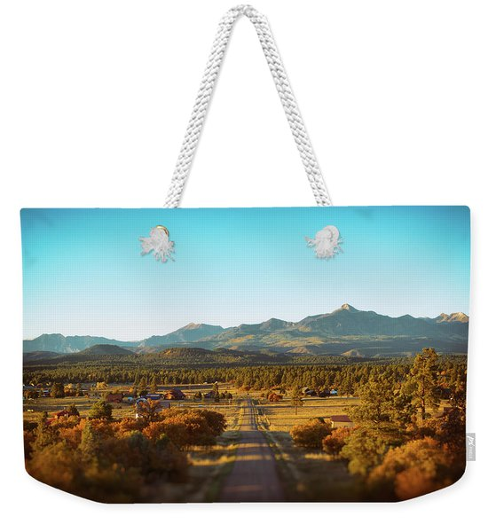Weekender Tote Bag featuring the photograph An Autumn Evening In Pagosa Meadows by Jason Coward