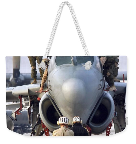 An Ea-6b Prowler Is Prepared For Launch Weekender Tote Bag