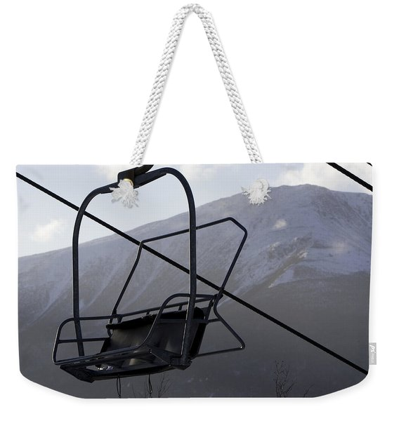 An Empty Chair Lift At A Ski Resort Weekender Tote Bag