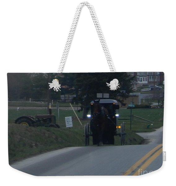 An Evening Commute Weekender Tote Bag