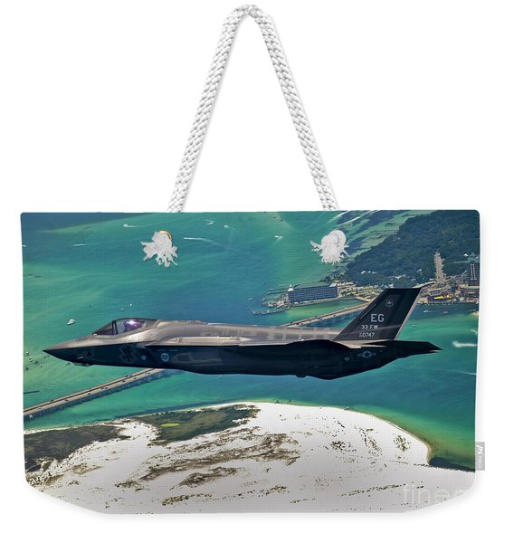 An F-35 Lightning II Flies Over Destin Weekender Tote Bag
