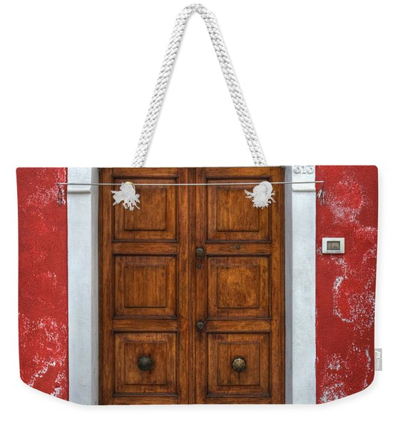 an old wooden door in Italy Weekender Tote Bag