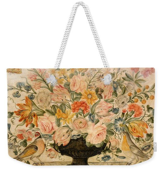 An Urn Containing Flowers On A Ledge Weekender Tote Bag