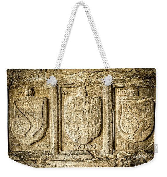 Weekender Tote Bag featuring the photograph Ancient Carvings by Nick Bywater