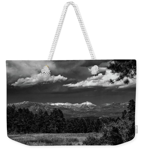 Weekender Tote Bag featuring the photograph As Summer Begins by Jason Coward
