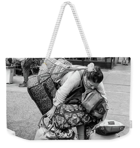 Weekender Tote Bag featuring the photograph Bag Lady by Eric Lake