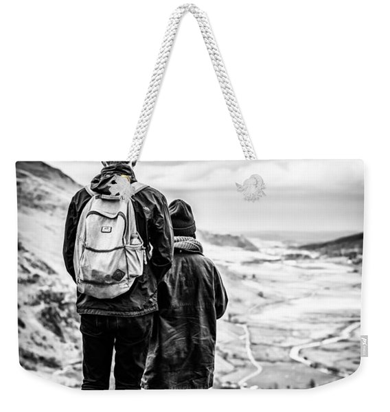 Weekender Tote Bag featuring the photograph On The Edge by Nick Bywater