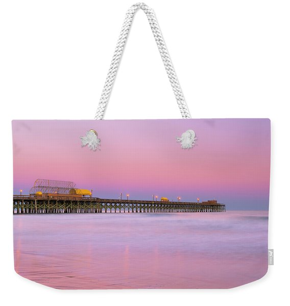 Weekender Tote Bag featuring the photograph Atlantic Ocean And The Apache Pier At Sunset In South Carolina by Ranjay Mitra