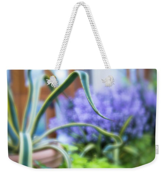 Weekender Tote Bag featuring the photograph Audrey IIi by Brian Hale
