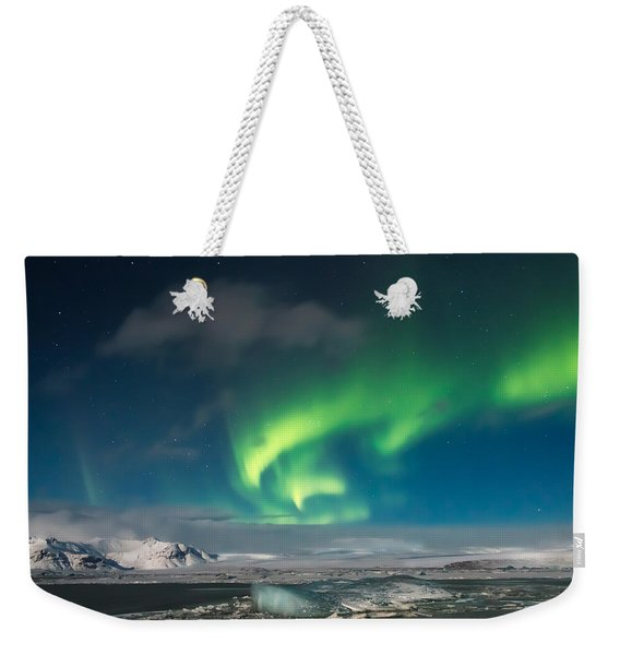 Weekender Tote Bag featuring the photograph Aurora Borealis by Susan Leonard