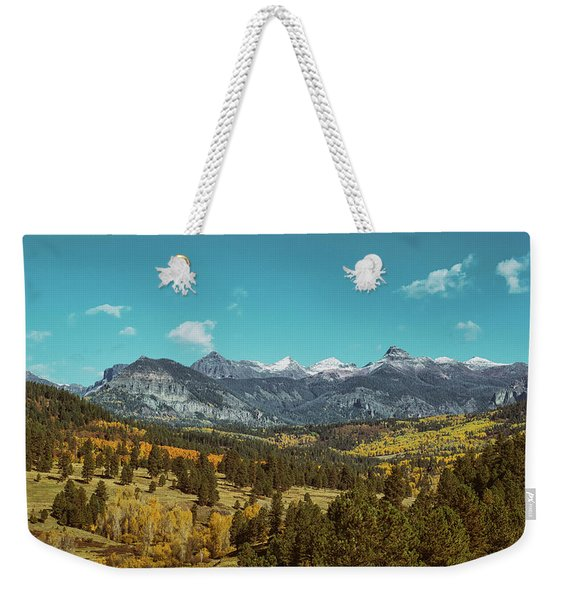 Weekender Tote Bag featuring the photograph Autumn At The Weminuche Bells by Jason Coward