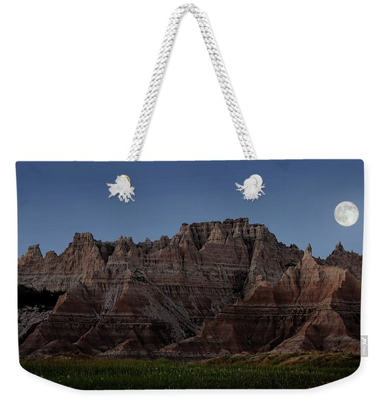Weekender Tote Bag featuring the photograph Badlands Moon Rising by Jemmy Archer