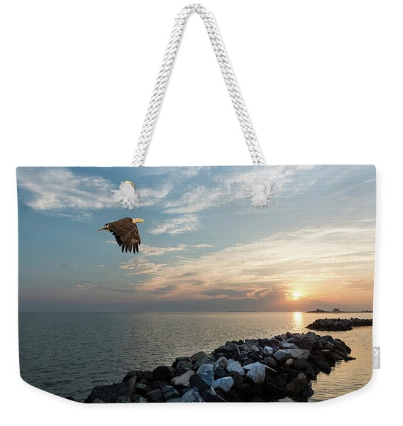Bald Eagle Flying Over A Jetty At Sunset Weekender Tote Bag