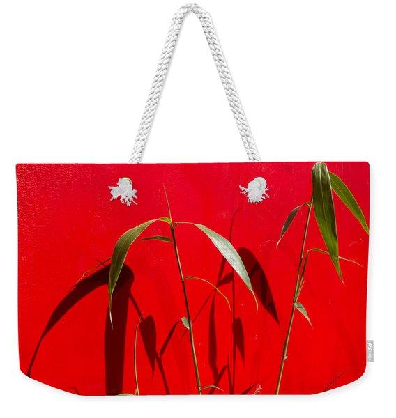 Bamboo Against Red Wall Weekender Tote Bag