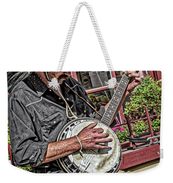 Weekender Tote Bag featuring the photograph Banjo Man Orange by Jim Thompson