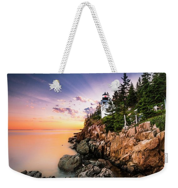 Weekender Tote Bag featuring the photograph Bass Harbor Lighthouse Sunset by Ranjay Mitra