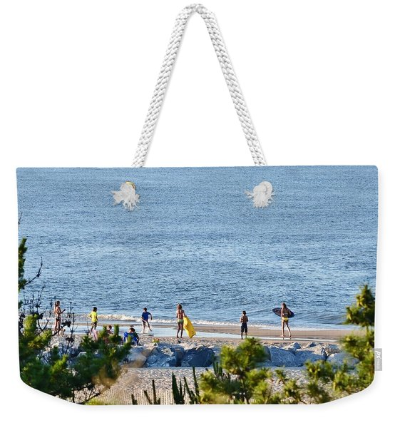 Weekender Tote Bag featuring the photograph Beach Fun At Cape Henlopen by Kim Bemis