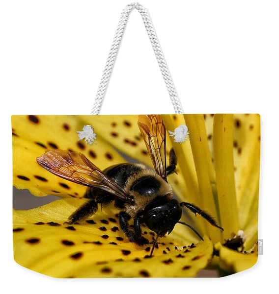 Weekender Tote Bag featuring the photograph Bee On A Lily by William Selander