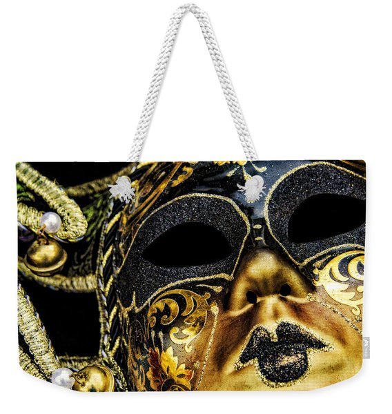 Weekender Tote Bag featuring the photograph Behind The Mask by Carolyn Marshall