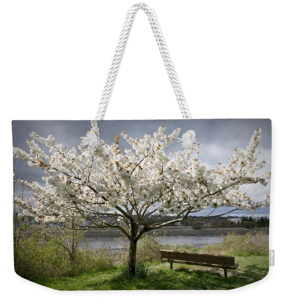 Weekender Tote Bag featuring the photograph Bench And Blossoms by Patricia Strand