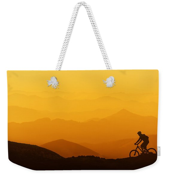 Biker Riding On Mountain Silhouettes Background Weekender Tote Bag