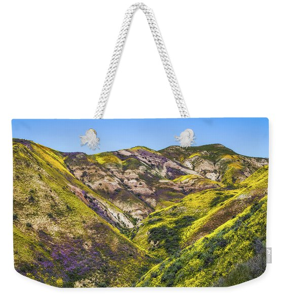 Weekender Tote Bag featuring the photograph Blanketed In Flowers by Laura Roberts