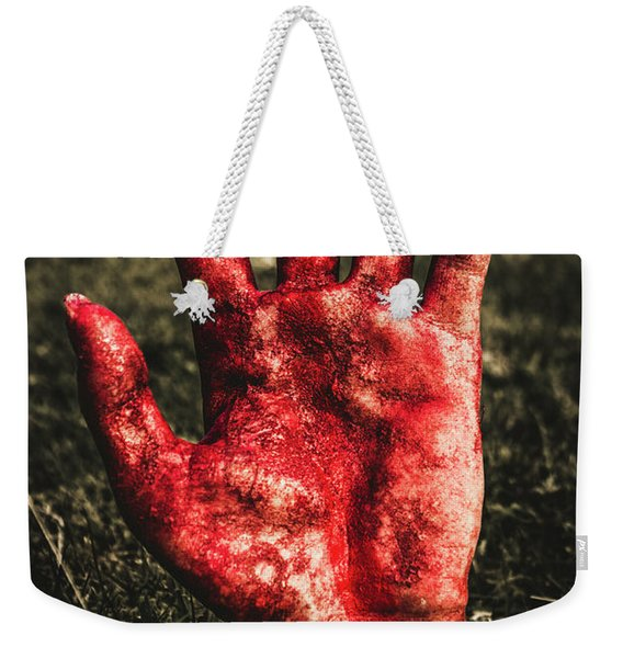 Blood Stained Hand Coming Out Of The Ground At Night Weekender Tote Bag